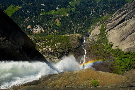 Stock Photo: 1598R-10032421 Yosemite Falls is the highest waterfall in North America at a total vertical plunge of 2,425 feet. Upper fall is 1,430 feet, while Middle Cascade is 673 feet. The lower fall measures 317 feet. Peak flow for the falls is late spring and is complety fed by snow-melt. Yosemite National Park, California, USA.