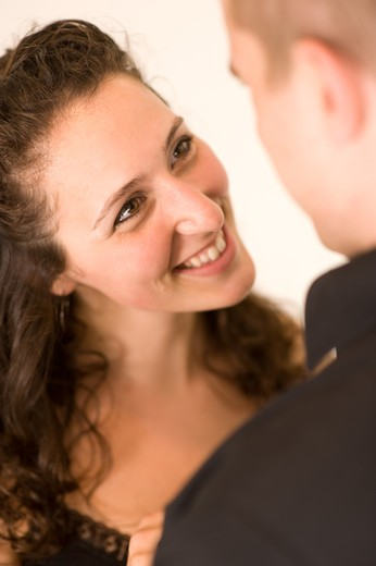 Beautiful smile from a radiant brunette woman. It looks like she is thanking her partner (fiance or husband) for something special he has done. : Stock Photo