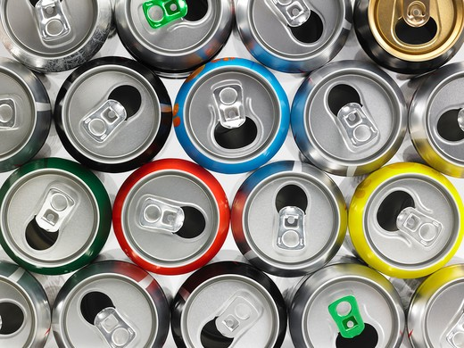 Stock Photo: 1598R-10034207 Variety of empty cans in different colours. The photograph shows cans of various refreshments and drinks after their content has been consumed. The cans are placed the one next to the other and their different colours have a nice effect to the overal composition. They have been shot from a high angle view and the frame of the shot is horizontal.