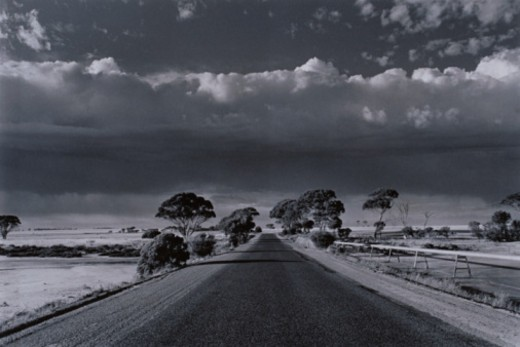 Stock Photo: 1598R-10035219 Clouds Over Road Across Plain