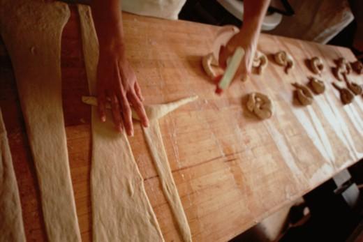Stock Photo: 1598R-10035227 Baker Making Croissants