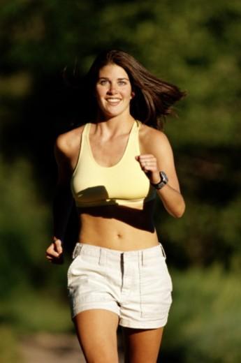 Stock Photo: 1598R-10038193 YOUNG WOMAN POWER WALKING
