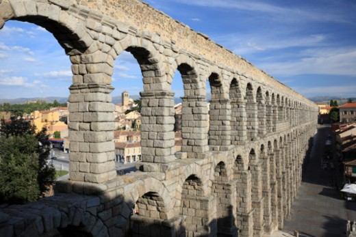 Stock Photo: 1598R-10038323 Segovia, Spain is a UNESCO world heritage site based on its old town and aqueduct.  The aqueduct is one of the most significant Roman engineering works in Spain.