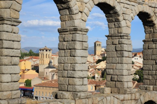 Stock Photo: 1598R-10038330 Segovia, Spain is a UNESCO world heritage site based on its old town and aqueduct.  The aqueduct is one of the most significant Roman engineering works in Spain.