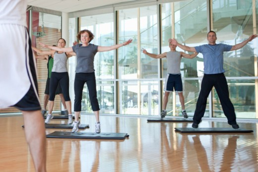 Stock Photo: 1598R-10038708 group of people working out in a fitness class