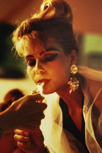 Portrait of blonde woman smoking : Stock Photo
