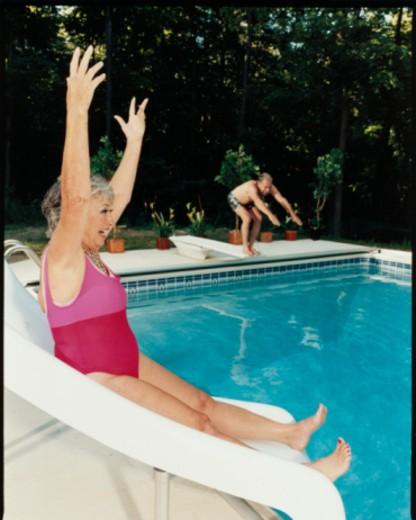 Stock Photo: 1598R-10043607 Woman on Pool Slide