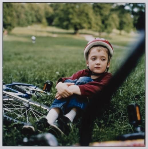Stock Photo: 1598R-10045567 Boy Sitting with Bicycle