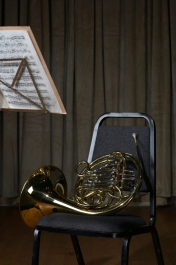 French horn on chair : Stock Photo