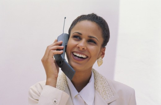 BUSINESSWOMAN W/CELLULAR PHONE : Stock Photo