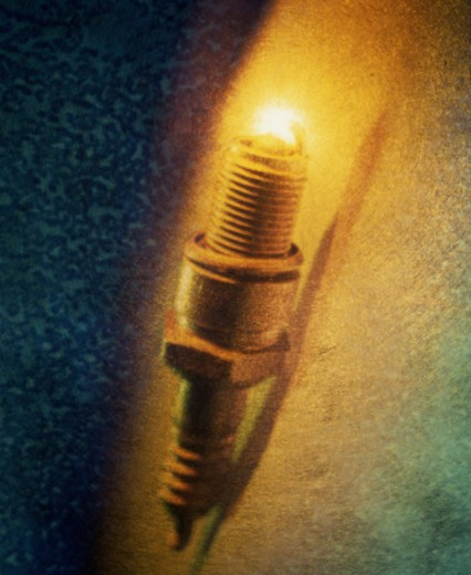 Spark plug igniting, full frame (textured) : Stock Photo