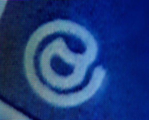 Stock Photo: 1598R-10057150 @ symbol on monitor, close-up (digital)