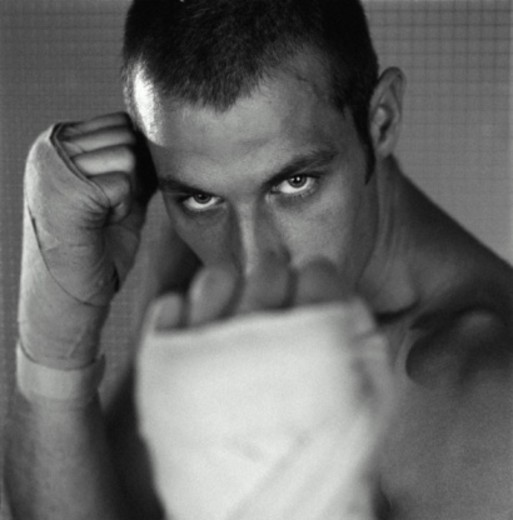 Stock Photo: 1598R-10064107 Boxer with taped hands, portrait, close-up (B&W)