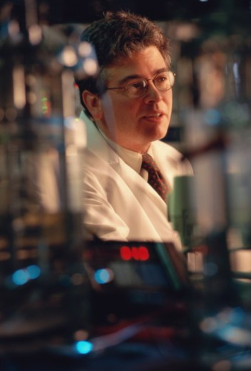 Medical researcher in laboratory : Stock Photo