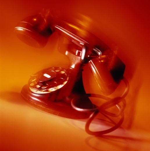 Antique telephone 'ringing' (blurred motion) : Stock Photo