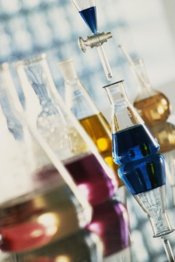 Stock Photo: 1598R-10066240 Flasks with different coloured liquids in laboratory