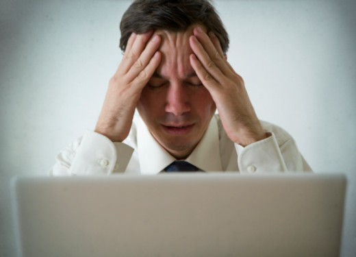 Stock Photo: 1598R-10066497 Man sitting at laptop, looking stressed