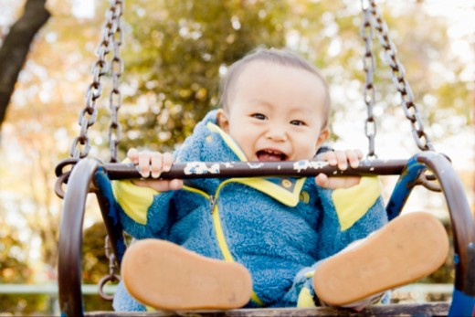 Stock Photo: 1598R-10068025 Baby who plays in park of autumn