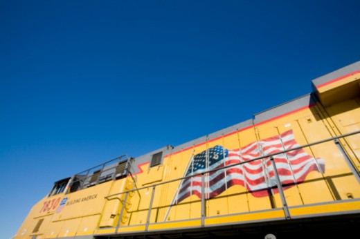 Yellow freight train with a painted American flag : Stock Photo