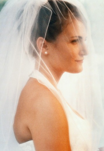 Bride wearing veil, portrait (soft focus) : Stock Photo