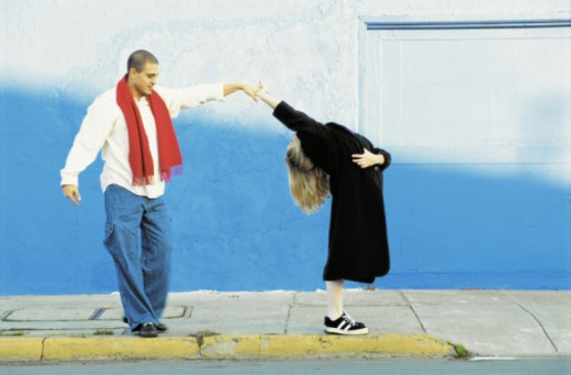 COUPLE DANCING IN THE STREET : Stock Photo