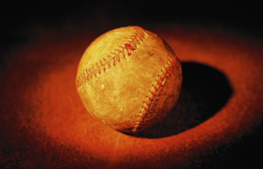 Stock Photo: 1598R-10070420 Worn baseball, close-up (red tone)