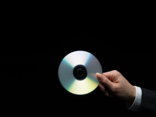 Stock Photo: 1598R-10070766 Woman holding compact disc, close-up of hand