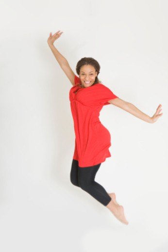 Studio portrait of teenage girl (16-17) jumping : Stock Photo