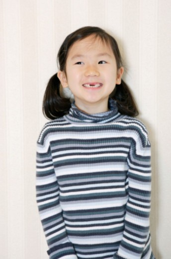 Stock Photo: 1598R-10071168 Studio shot of girl grinning