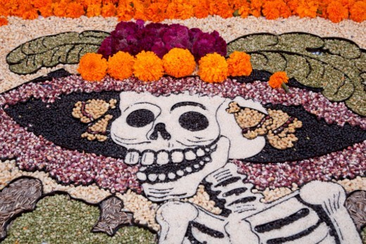 North America, Mexico, San Miguel de Allende, skeleton made of beans with marigolds at altar for Day of the Dead  celebration, also known as Dios de los Muertos.  Mexicans celebrate the Day of the Dead on November 1st and 2nd in connection with the Catholic holy days of All Saints' Day and All Souls' Day. : Stock Photo