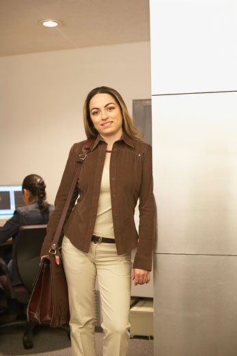 Stock Photo: 1598R-100739 Portrait of a young woman standing in an office