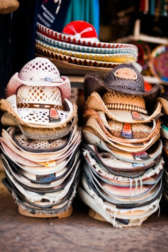 Stacks of cowboy hats outside of store front, Cabo San Lucas, Baja California Sur, Mexico : Stock Photo