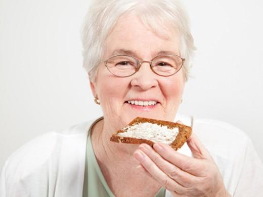 Senior having healthy breakfast : Stock Photo
