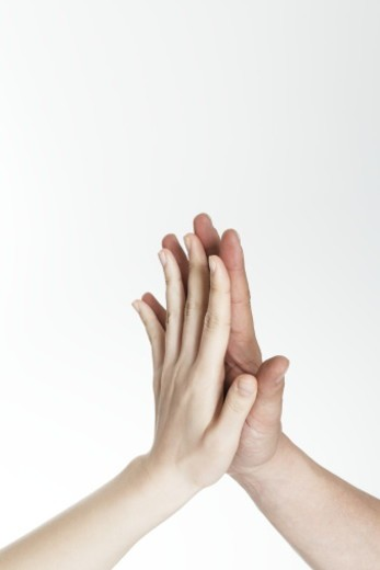 Man and woman touching hands : Stock Photo