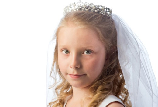 Portrait of an eight year old girl on the celebration of her first holy communion : Stock Photo