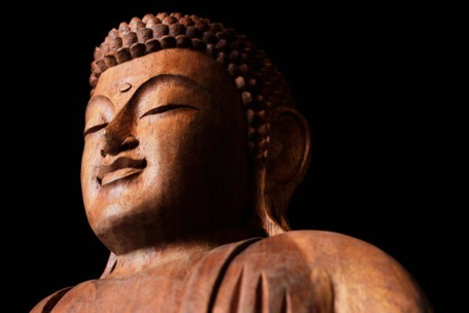 Close up of wooden Buddha's  head. : Stock Photo