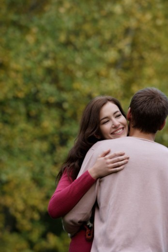 Stock Photo: 1598R-10077978 Young couple embracing
