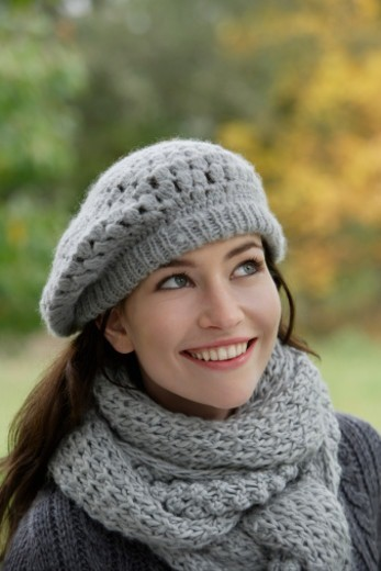 Stock Photo: 1598R-10078473 Young woman in knit hat and scarf