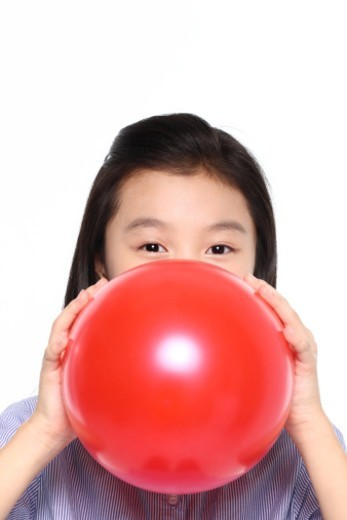 Stock Photo: 1598R-10078927 Girl blowing ballon