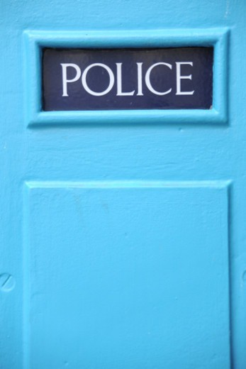 The word 'Police' on a blue police box, City of London, UK : Stock Photo