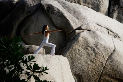 woman doing yoga on rock : Stock Photo