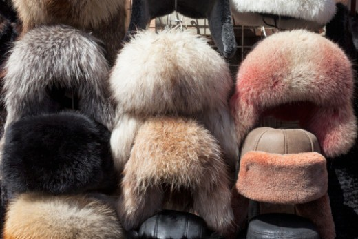 Stock Photo: 1598R-10081298 traditional Russian fur hats for sale to tourists in a craft market near the Church on Spilled Blood