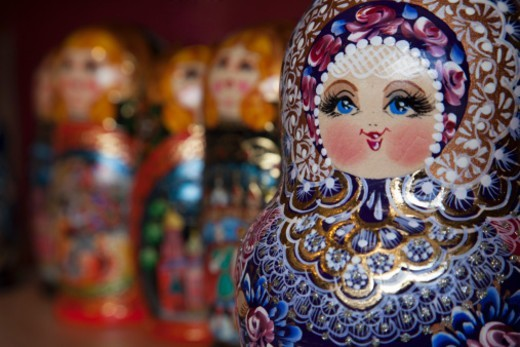 Stock Photo: 1598R-10081299 a group of beautifully painted Russian Dolls for sale to tourists in a craft market near the Church on Spilled Blood