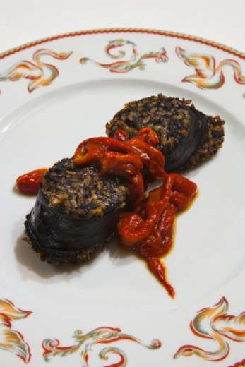 Stock Photo: 1598R-10081455 Black pudding from Burgos with red peppers. Meson del Cid Restaurant. Camino de Santiago (The way of St. James.) Burgos. Castilla y Leon. Spain