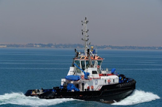 Suez Channel, Boat assistance : Stock Photo