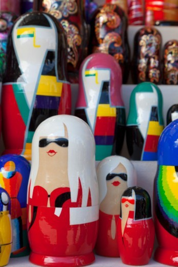 a group of Russian Dolls, painted in a modern style, for sale to tourists in a craft market near the Church on Spilled Blood : Stock Photo