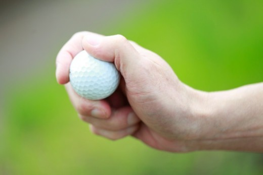hand holding golf ball,close-up : Stock Photo