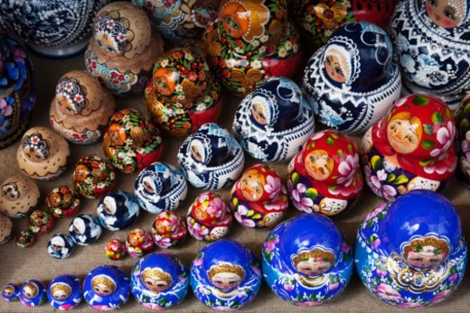 Stock Photo: 1598R-10081955 a group of Russian Dolls for sale to tourists in a craft market near the Church on Spilled Blood