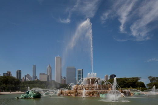 Buckingham Fountain Spraying water, with Chicago in background. Bennett, Parsons & Frost : Stock Photo