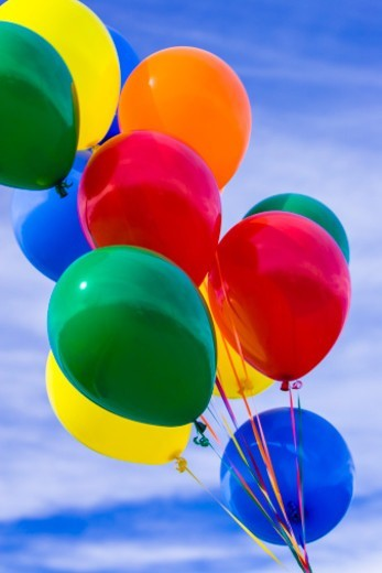 Bunch of colorful balloons outdoors on a sunny day with blue sky : Stock Photo